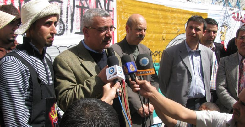 Photo of Palestinian Youth Call for National Reconciliation through Wall Painting Activity